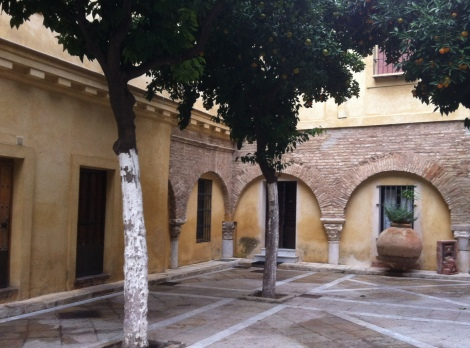 Patio de Naranjas of El Salvador church, with Moorish arches - can you spot the oranges in the trees?