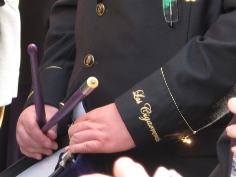 The name of the hermandad is embroidered on band members' suits.