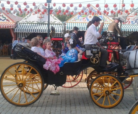 Riding around the Feria in a carriage - every little girl's dream.