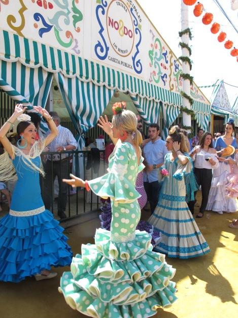 Dancing Sevillanas outside a caseta.