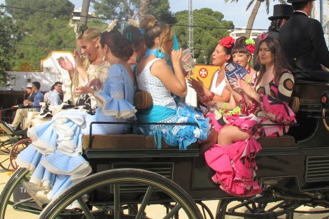 All dressed up in the carriage with your girlfriends, singing - the perfect feria afternoon.