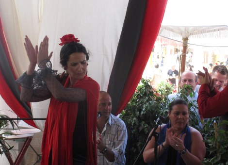 The flamenco bailadora claps out the rhythm -note the Tio Pepe colours.
