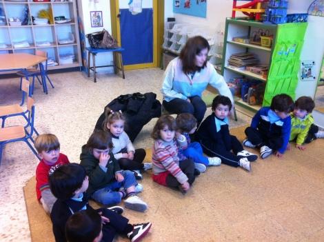 Lola's teacher with her classmates.
