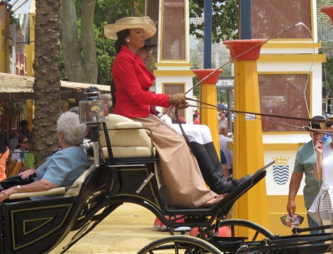 A lady driving a carriage on Ladies' Day.