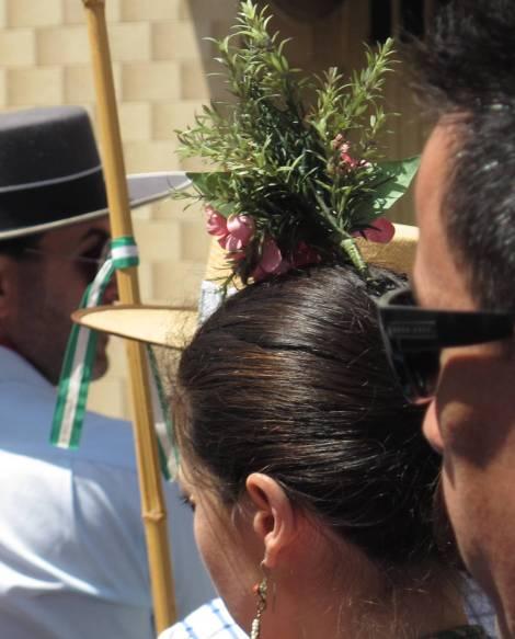 This romera (pilgrim) wears romero (rosemary) in her hair.