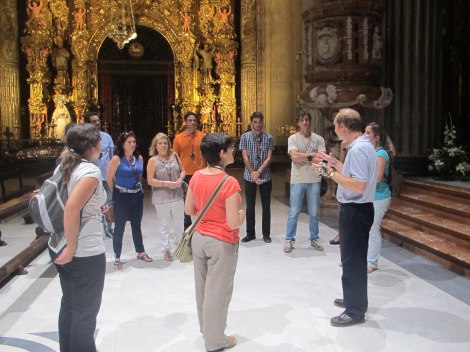 Florencio in full flow, inside the main basilica with a gilt retablo in the background.