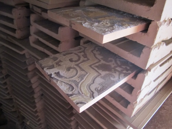 Tiles as they would have been fired in the kiln.