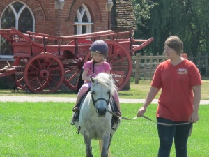Every little girl loves a pony ride-