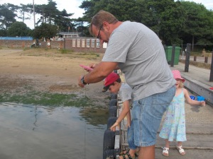 Crabbing at Bawdsey - Dad shows them the technique.