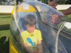 Trying out a glider cockpit.