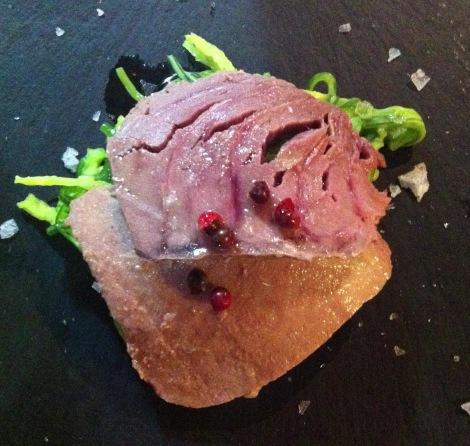Tuna fillet on wakame seaweed.