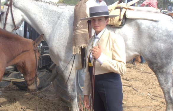 Horsemanship starts young in Valencina, and obviously he has to look the part, in his traje corto and Cordobes hat.
