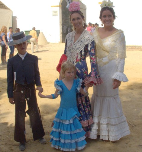 My daughter Lola poses with some romeros - pilgrims (Chaucer overtones make that word sound so wrong in English).
