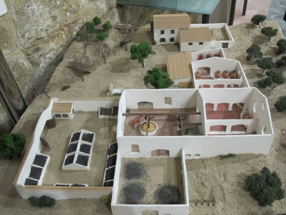 Model of olive finca - they arrive on the left, are crushed (centre room), and then bottled in the large jars top right.