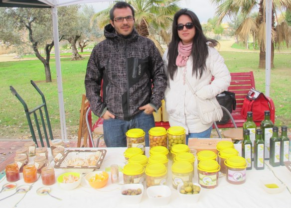 The team from De La Huerta a Tu Casa with their olive oil and jams.